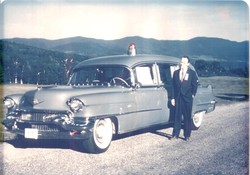 Founder, Ralph M. Knight Jr. in front of his new blue hearse.  Now the standard color for the company's fleet, this was the first hearse in the state that wasn't black or gray.